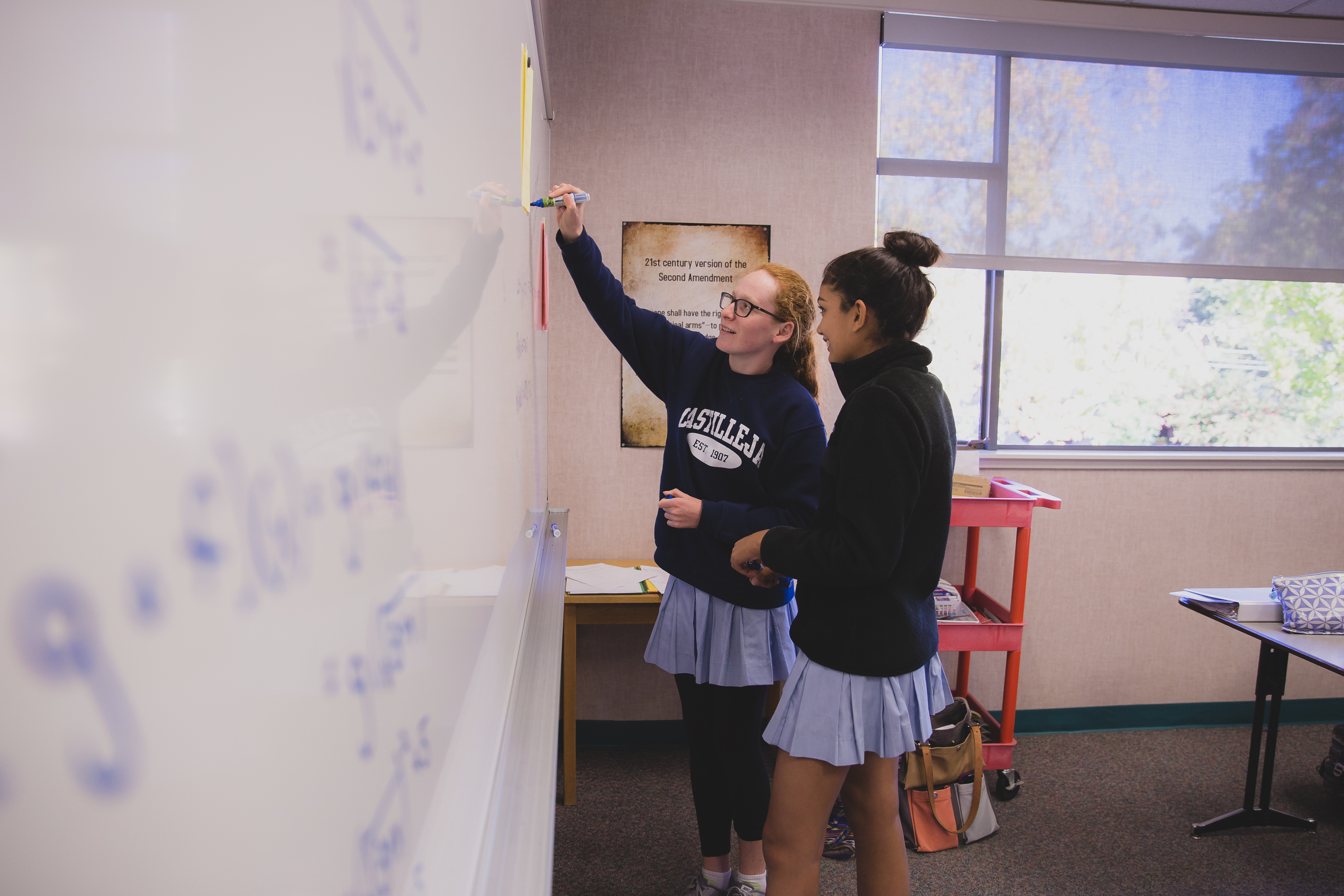 Math students work in pairs to figure out the best approach to algebraic problems